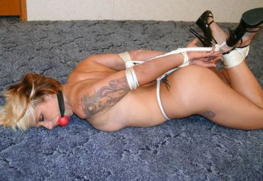 Awesome Blond Slave in High Heels Gets Hogtied and Ball Gagged for Fun