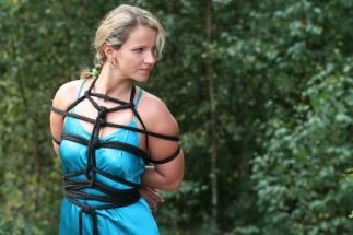 Beautiful Blonde in a Dress Gets Tightly Bound and Disciplined Outside