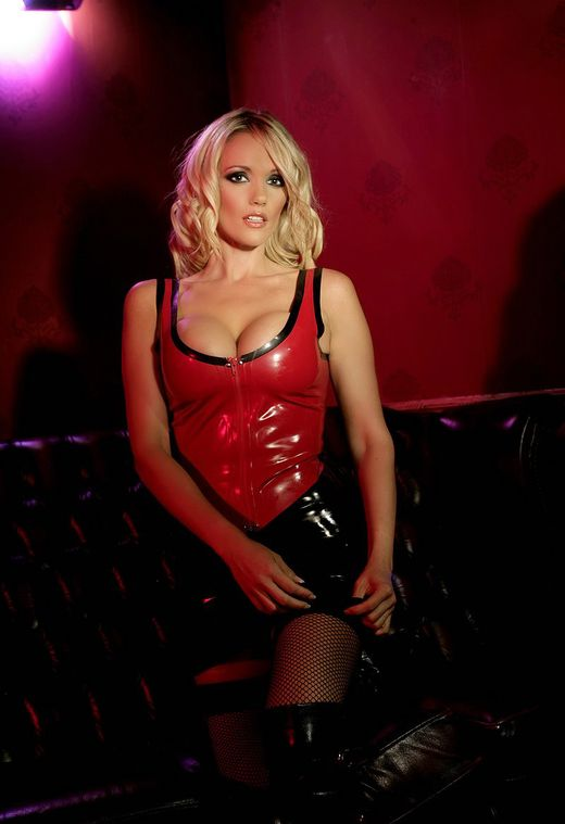 Beautiful Blonde in Latex and High Heel Boots Chained and Stripped