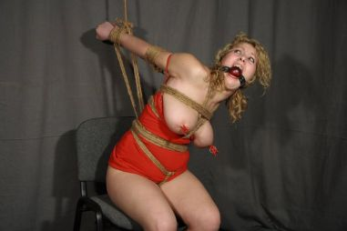 Busty Blond Slave Gets Tightly Bound and Ball Gagged for Punishment