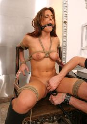 Sexy Brunette in High Heel Boots Gets Bound, Bit Gagged and Tortured