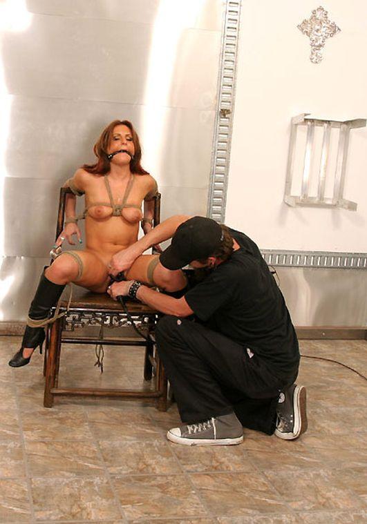 Sexy Brunette in High Heel Boots Gets Bound, Bit Gagged and Tortured