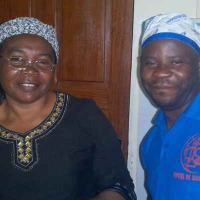 Nurse Jean Paul with patient wearing the first pair of glasses he had made.