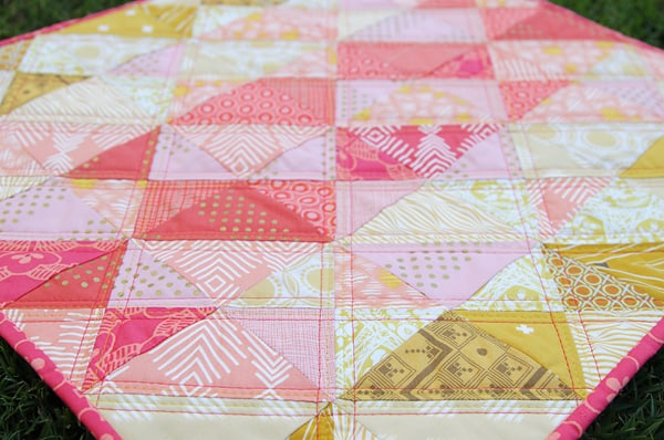 Click through for a tutorial on this Coral Mini Quilt and details on the lap-sized version; at Bonjour Quilts