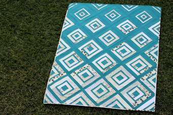 Teal version of Diamonds in the Deep quilt pattern