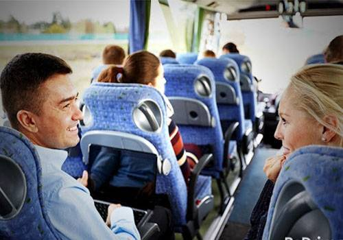 man and woman talking in a bus