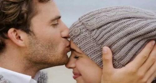 Man-kiss-on-her-womansForehead