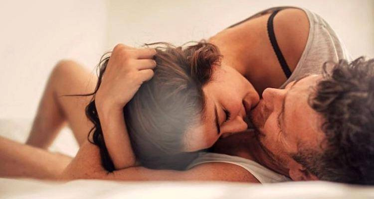 a-couple-cuddling-in-bed