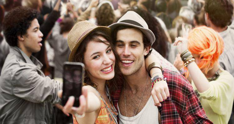 man and woman clicking selfie