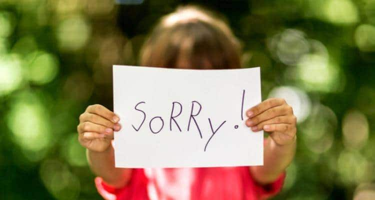 Girl saying sorry