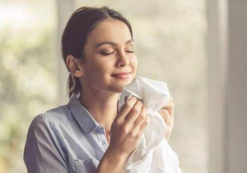 woman smelling husband's shirt