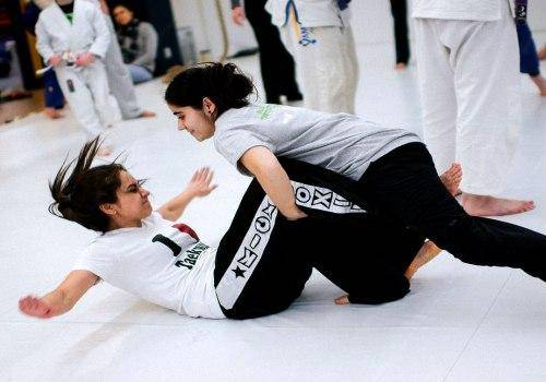 two woman learning karate