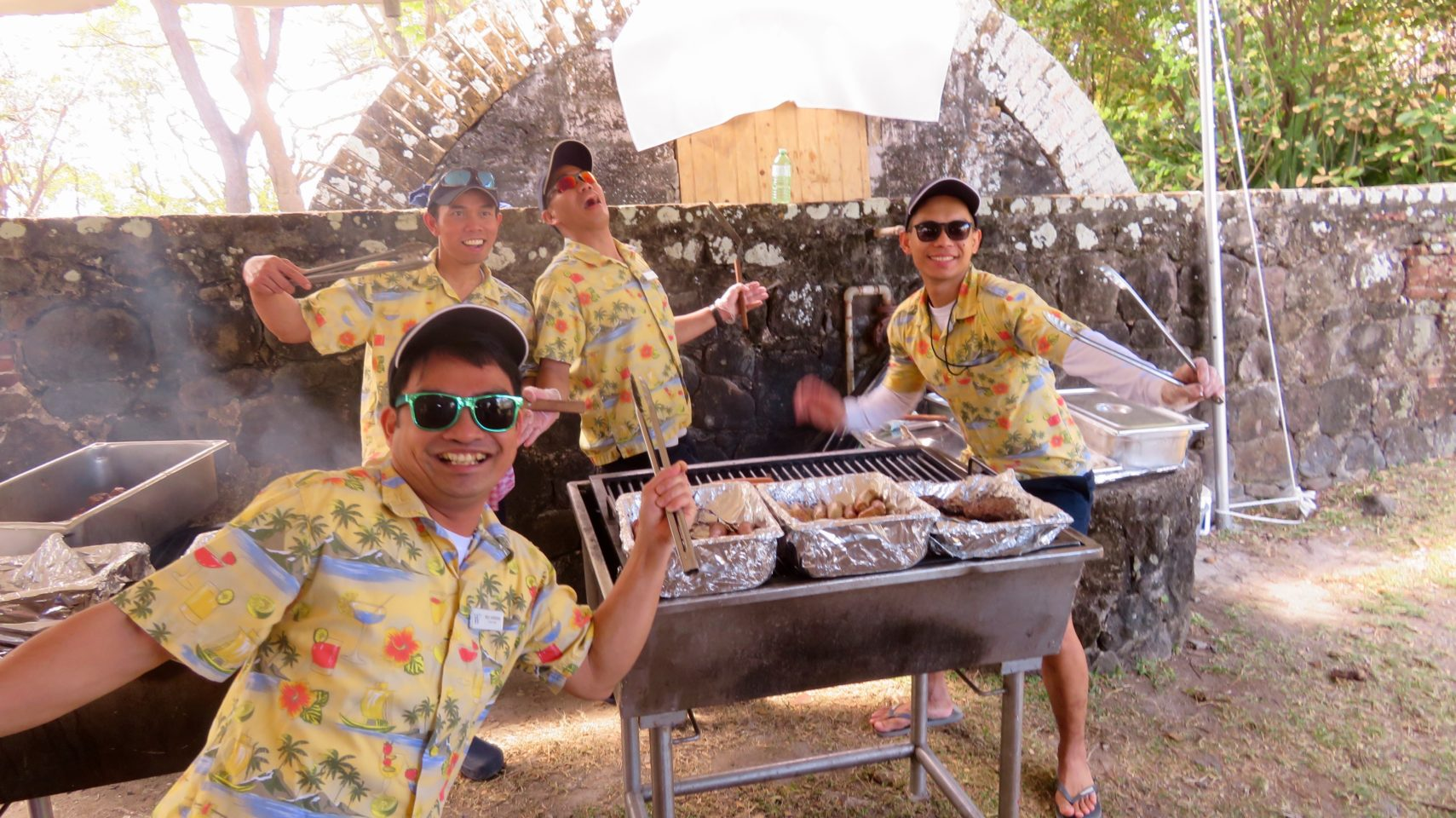 Windstar Cruises ~ my favorite restaurant servers posing with panche at our Island Barbeque, a Windstar tradition