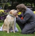 man kissing dog