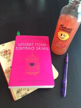 book and a beverage - Under Rose-Tainted Skies