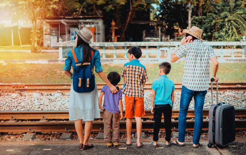 Family traveling by train