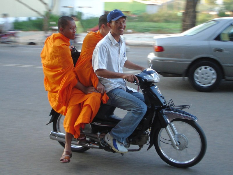 Monks riding a motodop in Cambodia