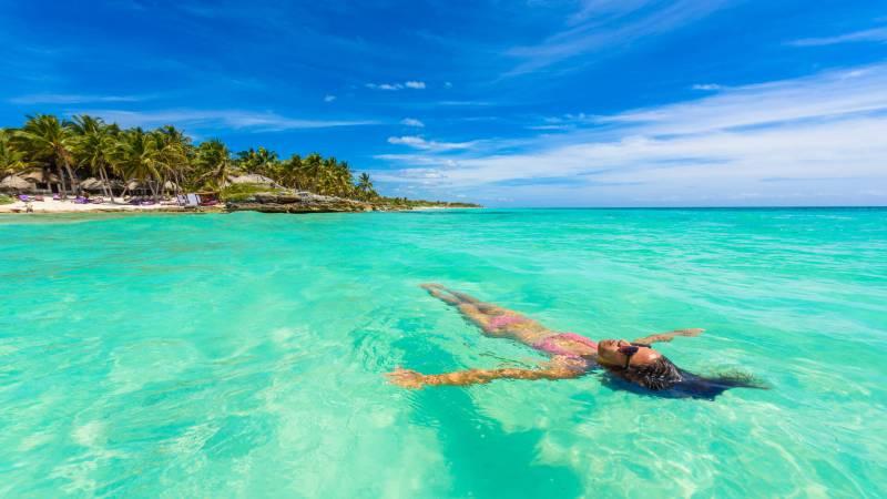 Solo female traveler at Paradise Beach in Tulum
