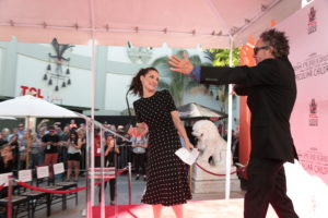 """Winona Ryder celebrates with Tim Burton at his Hand & Footprint Ceremony presented by 20th Century Fox with the release of his newest film """"Miss Peregrine's Home for Peculiar Children"""" at the TCL Chinese Theatre in Los Angeles, CA on September 8, 2016. (Photo: Alex J. Berliner/ABImages)"""