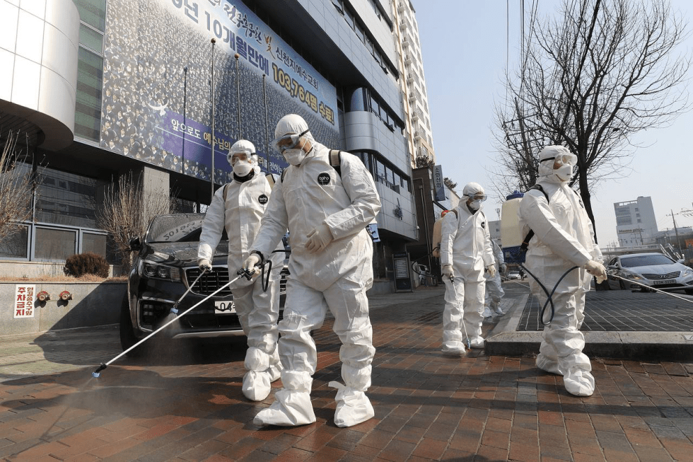Workers wearing protective gear in South Korea.ASSOCIATED PRESS