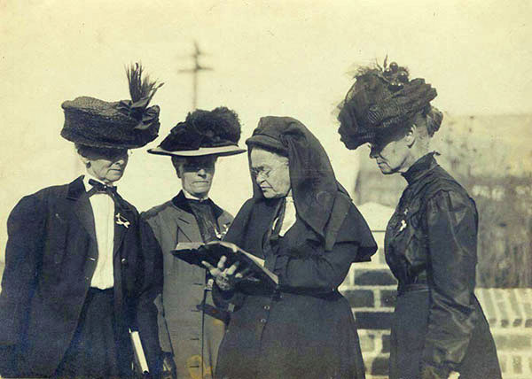 Carry Nation, reading the Bible circa 1900, appears to be of medium height.