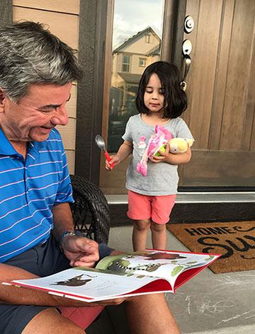 Grandpa and Priya reading Grumpy Monkey