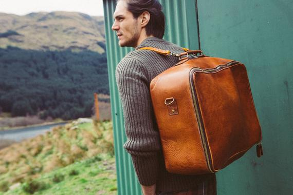 man with leather bag
