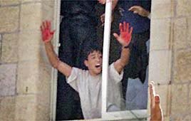 Palestinians proudly display bloodied hands from murdering Jews