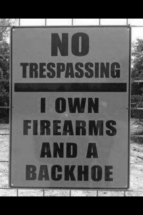 No trespassing firearms and a backhoe