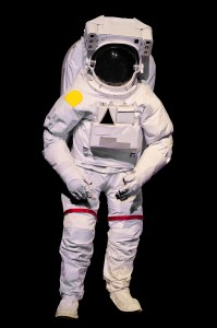 Astronaut in space suit against a black background.