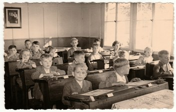 black and white vintage photo of kids in a classroom listening to lecture on sequence of return risk.
