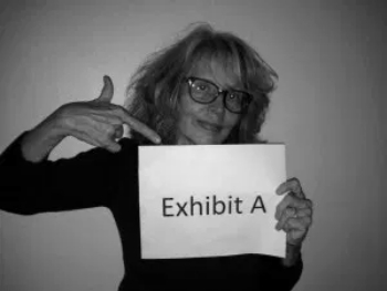 Black and white photo of author holding a sign that says Exhibit A--signifying how not to buy an annuity.
