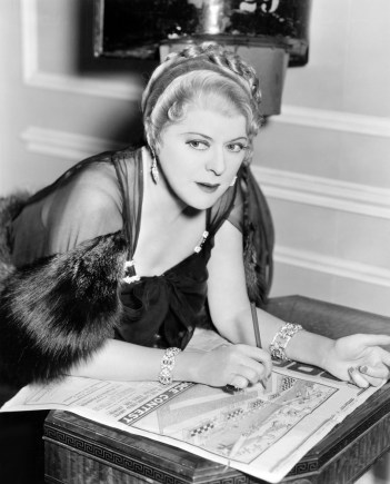 Black and white retro photo of woman studying her state's guaranty fund so she can get redress from an annuity bankruptcy.