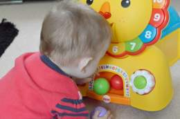 Fisher-Price 3-in-1 Sit, Stride & Ride Lion - coloured balls