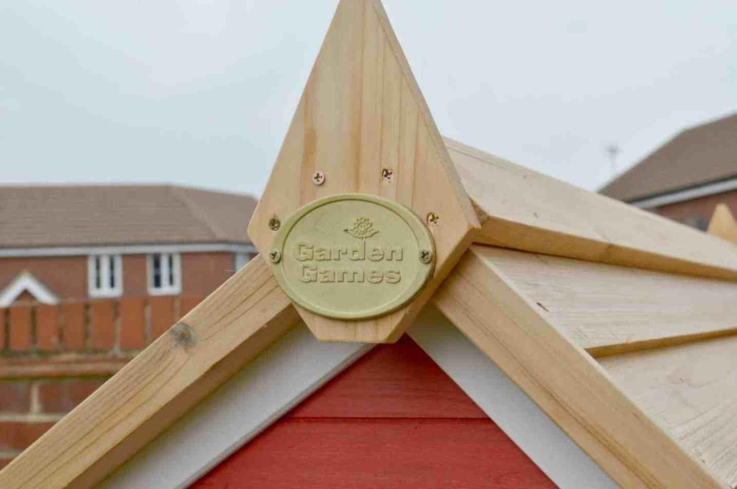 Crooked Mansion Wooden Playhouse - Garden Games Logo