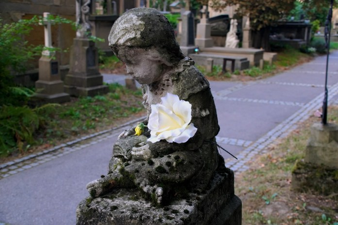 child bereavement statue with rose