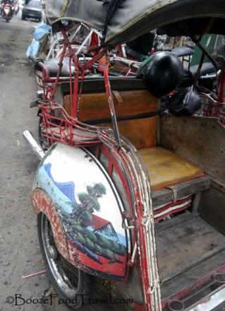 Every bicycle taxi has a different scene painted on the side