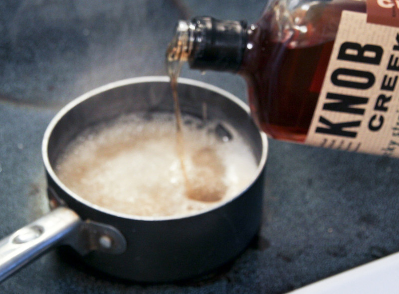 boozy apple dumpling bourbon sauce