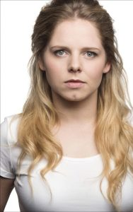 A photo of Dawn Sievewright. She has long blonde hair with brown roots and blue eyes