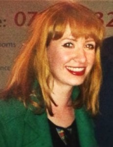 A photo of Rebecca Hamilton. She has medium length blonde hair with a fringe and a big smile.