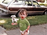 Rags sporting a summer-cut and me holding the remains of a freshly eaten Popsicle. 1981