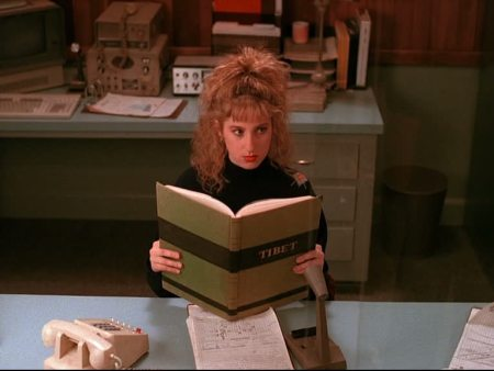 Kimmy Robertson (Lucy Moran) reading a Tibet Book