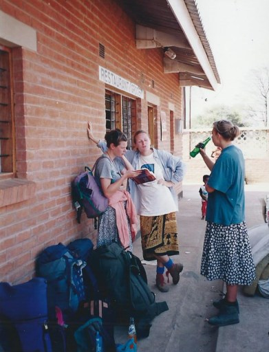 Female backpackers at border with skirts