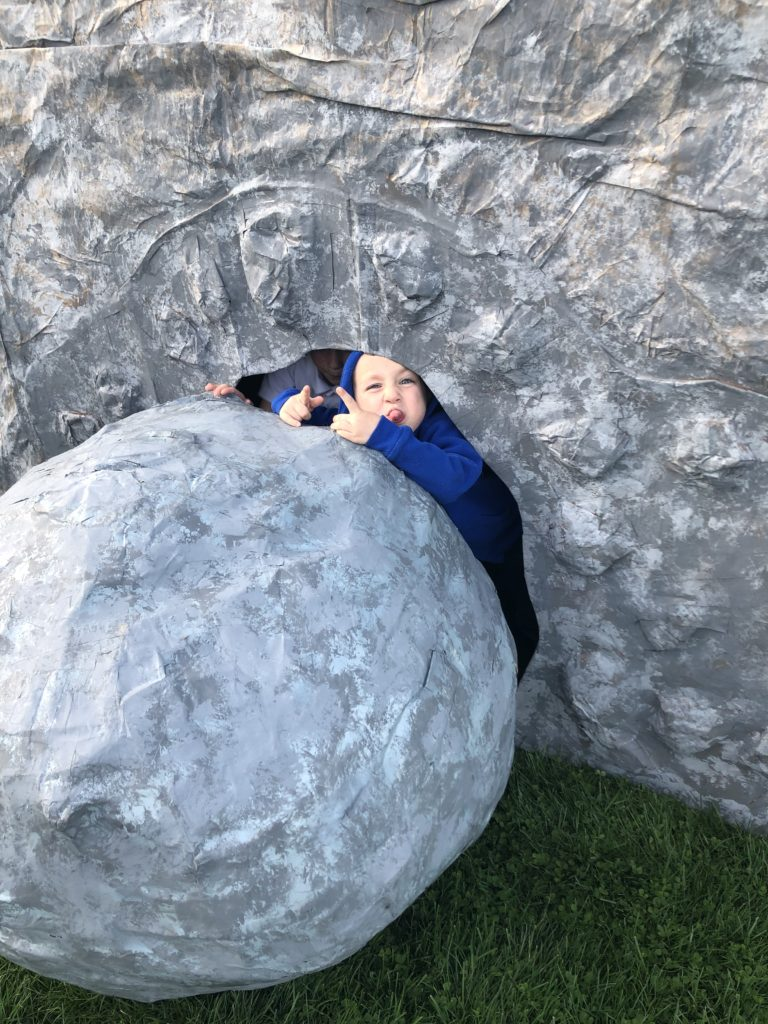 Kids enjoying faux tomb and boulder