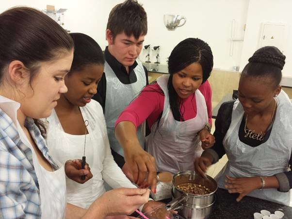 Boston Students learning the skills of chocolate making at The Chocolate Den, (before Lockdown!)