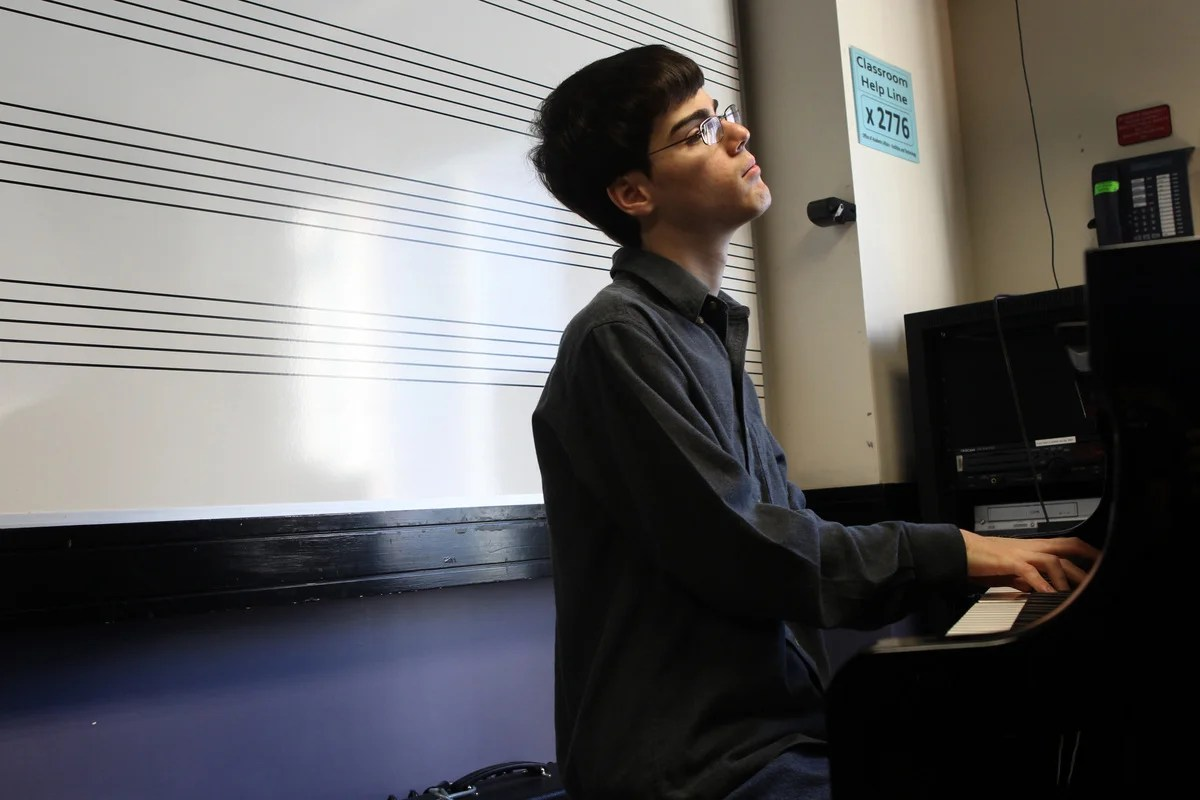 Matt Savage in a music lab at Berklee College of Music. He will graduate today, on his 20th birthday.