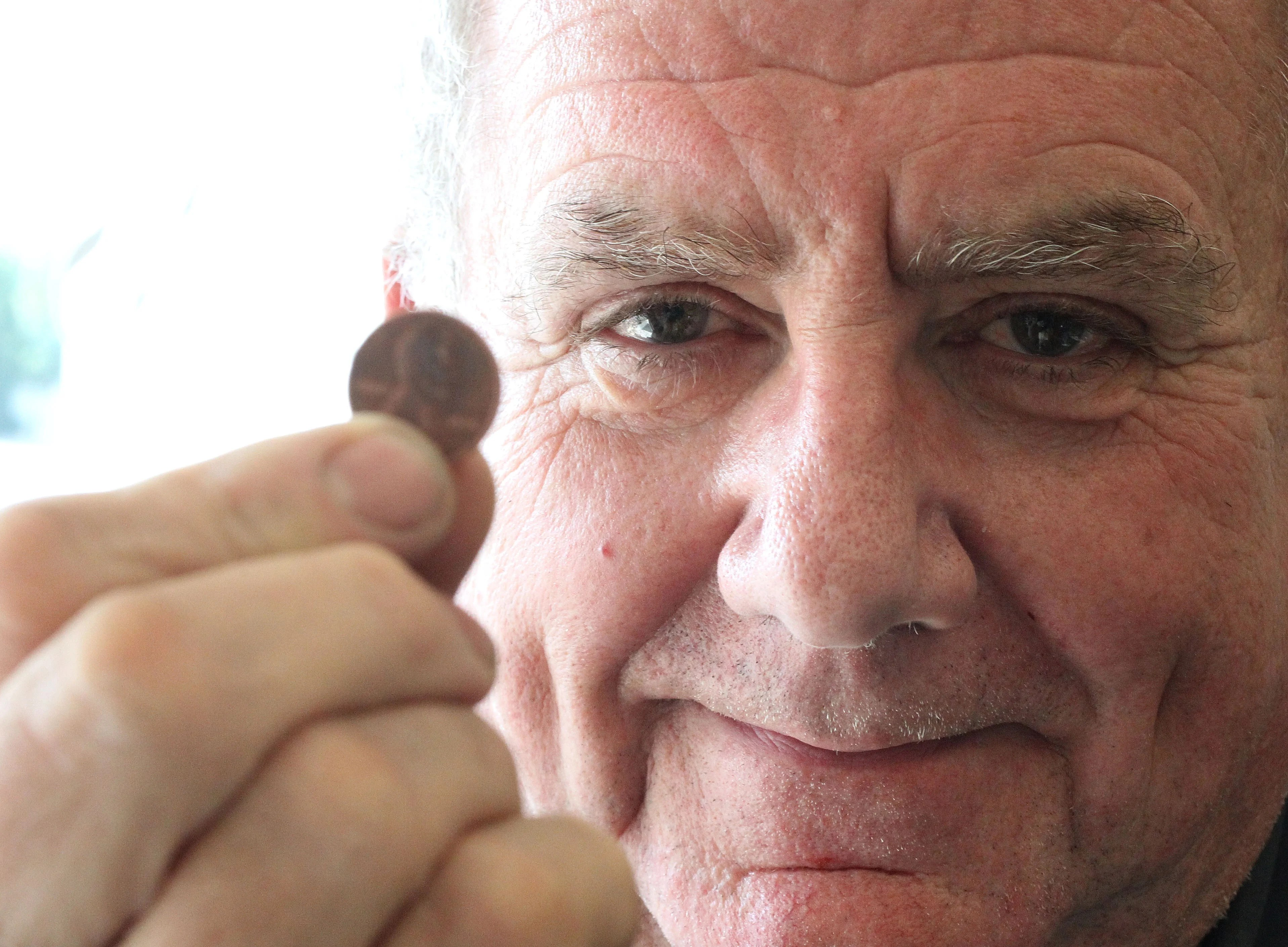 Thomas Daigle paid his last mortgage payment in pennies.