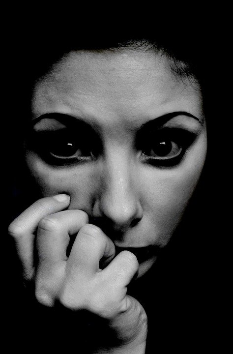 Stark balck and white portrait of anxious woman