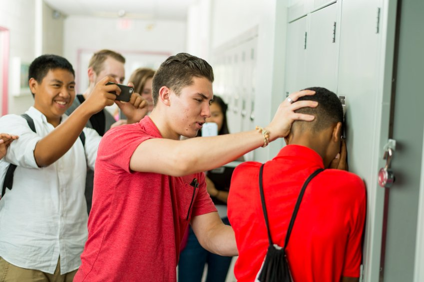 Group of high school boys bullying another student