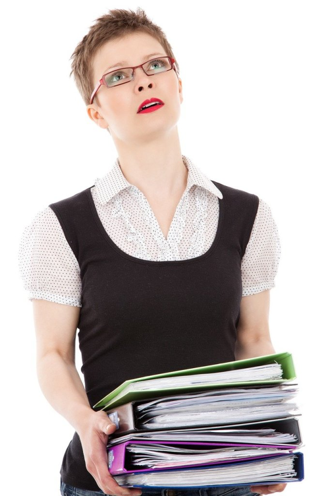 Stressed woman carrying papers
